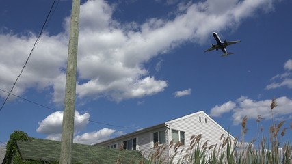Plane Flying Over House