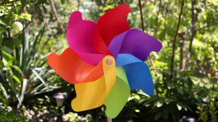 Colorful pinwheel toy against blue sky