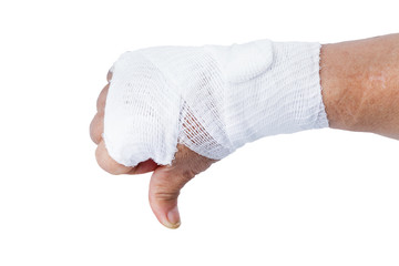 Thumb down showing by hand with white bandages isolated