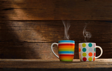 Cup of coffee with smoke on old wooden background © amenic181