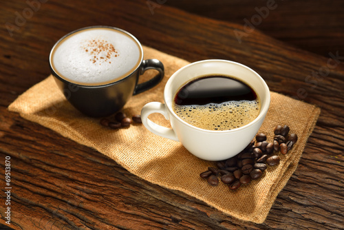 Cup of coffee and coffee beans on burlap sack