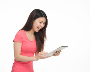 Young asian girl happy reading social network news on her tablet