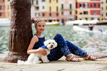 Portrait of lovely girl with dog - Portofino, Italy