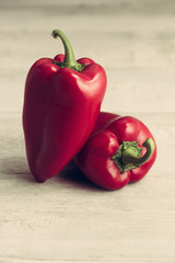 Sweet red peppers, on a wooden background