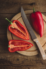 Sweet red peppers on a wooden chopping board