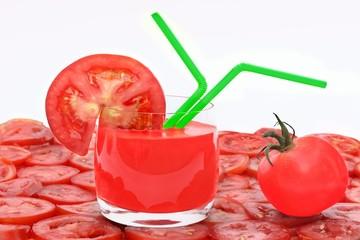 Tomato Juice in glass, tomato and tomato slice