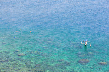 People snorkeling in turquoise water on Bali