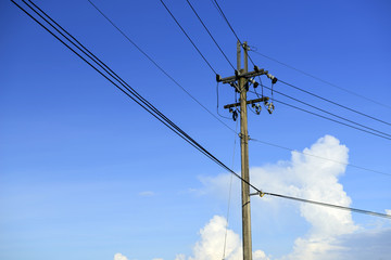 Power lines on blue sky