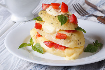 potatoes with mozzarella, tomato and basil closeup horizontal