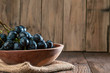 canvas print picture - grapes in  wooden plate