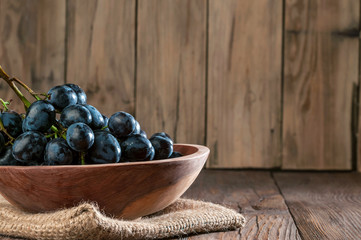 grapes in  wooden plate