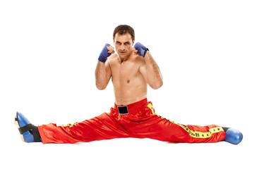 Kickboxer isolated executing a split