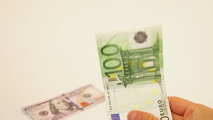 Choosing one hundred euro banknote over dollars