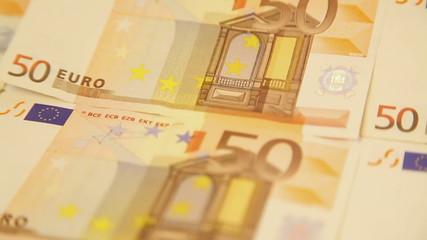 Closeup of panning around euro banknotes