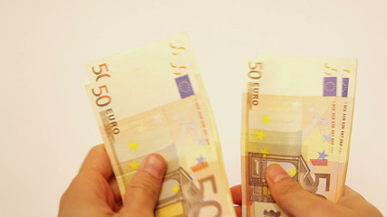 Closeup of counting handful of euro banknotes