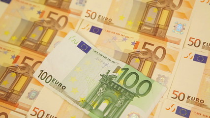 Panning around fifty and one hundred euro banknotes