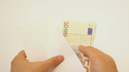 Closeup of taking euro banknotes from envelope