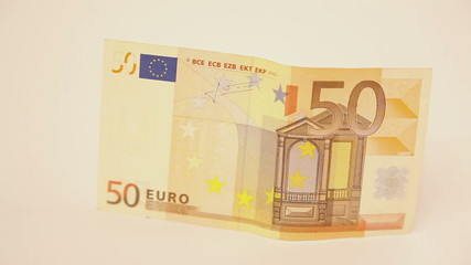 Zoom on fifty euro banknote standing on side