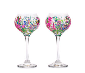 Two wine glasses with acrylic drawings.