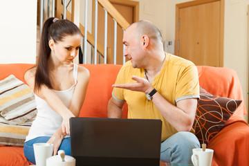 Man and woman at  laptop