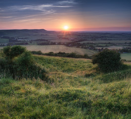 Beautiful Summer sunset over countryside landscape