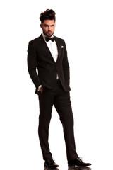 relaxed elegant man in tuxedo