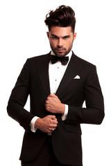 stylish man in elegant black suit and bowtie
