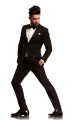 fashion man in tuxedo looking to side