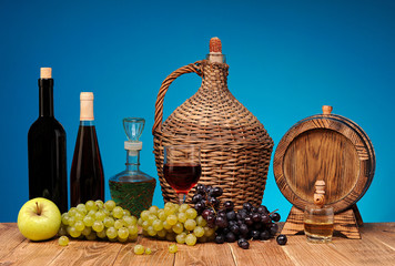 Wine bottle and glass, apples and grapes