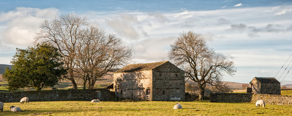 Panorama landscape traditional stone barn in Autumnal countrysid