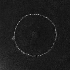 seam in the form of a circle on a black leather background