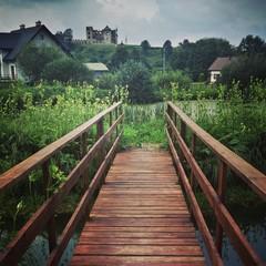 Beautiful landscape footbridge castle ruins wild east nature