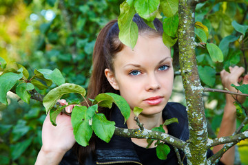 Portrait of the girl among foliage