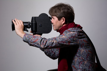Portrait of a fashion cameraman with old movie camera