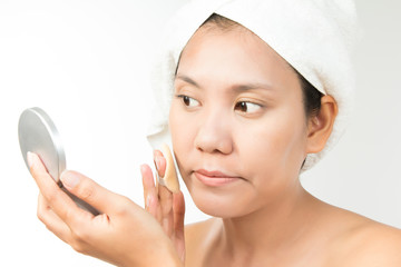 woman with perfect health skin of face and bath towel on head