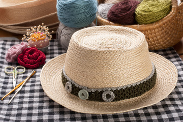 Woven hat decorated with crochet.