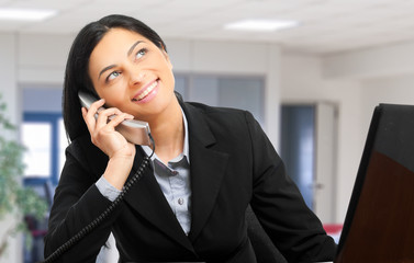 Businesswoman at the phone in the office