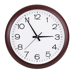 Round clock shows five minutes to three