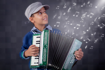 little musician playing the accordion