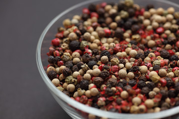 Mixed peppercorns in a glass bowl