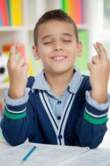 schoolboy keeps fingers crossed