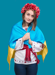 Portrait of attractive young  girl in national dress with  Ukrai
