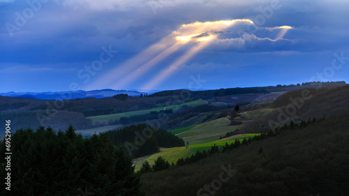canvas print picture Sunrays trough the Clouds