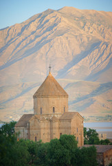Armenian church in Akmadar with mountain in background, Turkey