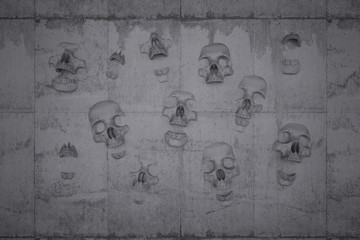 Skulls on a wall of concrete