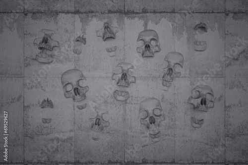 canvas print picture Skulls on a wall of concrete