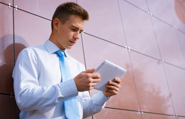 Businessman Looking Down at Tablet Computer