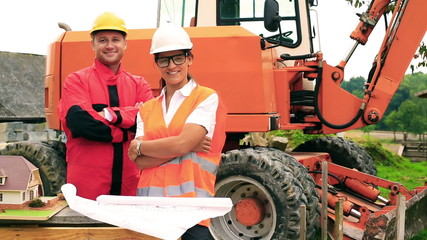Engineer and her worker smiling on the construction site