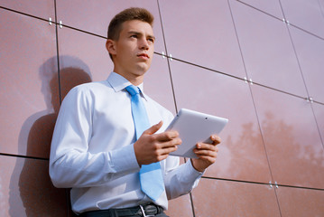 Businessman with Tablet Computer Looking Away
