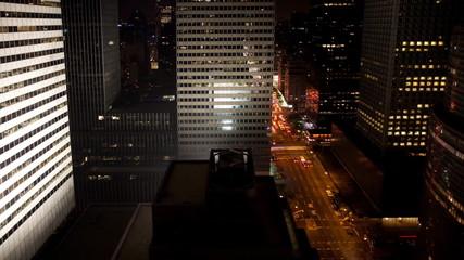 A stream of traffic at night in Manhattan